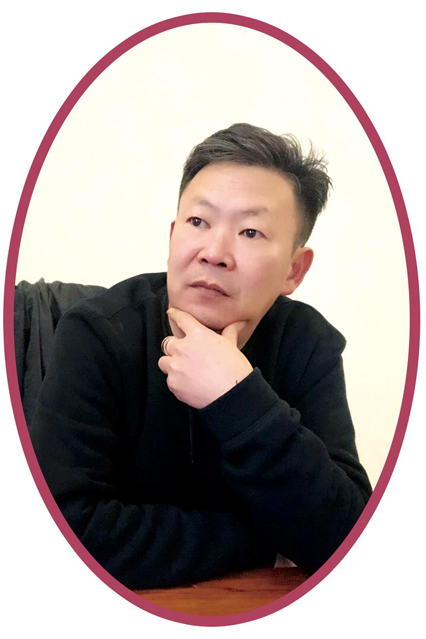 福清市慈善总会侨乡义工总队队长何坤华.jpg